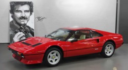 Thomas Magnum - Tom Selleck portrait painting by Peter Engels next to the legendary Ferarri