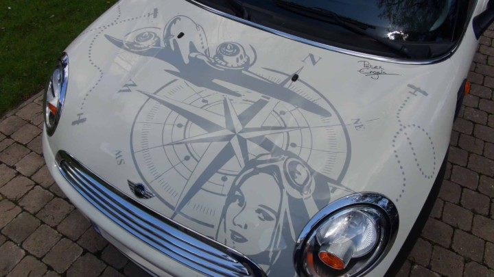 Design by Peter Engels for an aviation art car with various vintage propeller airplanes (also on the sides and the back), a compass and the vintage portrait of the pilot with aviator goggles