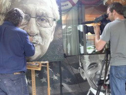 The filming of the final stage of the Bob Mendes portrait painting by Peter Engels