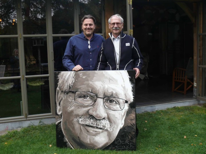 Thriller writer Bob Mendes and portrait painter Peter Engels with the painting