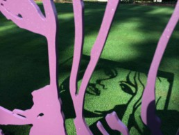 The sun and the Brigitte Bardot sculpture by artist Peter Engels create a shadow spactacle