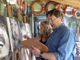 Montana Engels and Peter Engels, father and daughter with the Beatles portrait painting