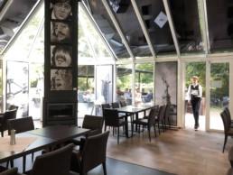 The restaurant of Kasteel Tivoli, Mechelen, Belgium. Beatles portrait painting by Peter Engels