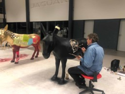 Artist Peter Engels working on the James Bond art donkey. Donkey Parade