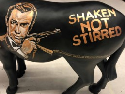 At one side there is the portrait of Sean Connery. James Bond donkey by Peter Engels, Donkey Parade art auction.