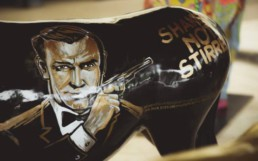 James Bond donkey by Peter Engels. All 007 movie titles are written around the donkey's belly. Donkey Parade art auction for charity.