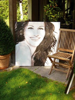 Julia Roberts portrait painting by Peter Engels drying in the sun