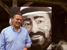 Artist Peter Engels with the Luciano Pavarotti portrait painting