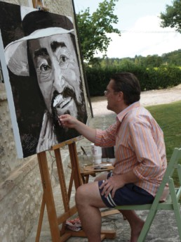 Peter Engels working on the Luciano Pavarotti portrait painting on the terrace of the house in Tuscany