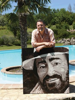 Peter Engels with the Luciano Pavarotti portrait painting at the house in Tuscany