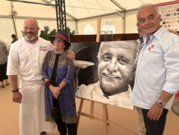 From left to right: celebrity television chef Philippe Etchebest, Madame Roger Vergé and mayor of Mougins Roger Galy with the Roger Vergé portrait painting