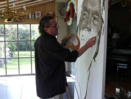 Peter Engels working on the Richard Branson portrait painting in his atelier