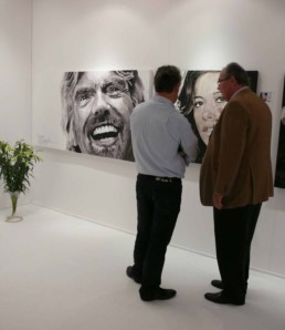 Art dealer Walter Spruyt discussing the Richard Branson portrait painting by Peter Engels at the Art Nocturne exhibition in Knokke (Belgium)