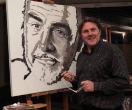 Peter Engels working on the Sean Connery portrait painting.