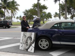 Peter Engels transporting the unfinished Sean Connery portrait painting prior to the art gala night on board of mega yacht Sea Fair during Art Basel Miami