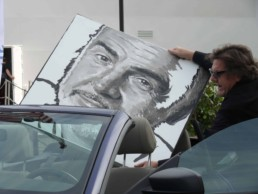 Peter Engels transporting the unfinished Sean Connery portrait painting to the art gala night on board of mega yacht Sea Fair during Art Basel Miami