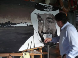 Peter Engels working on the Sheikh Khalifa portrait painting