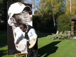 Peter Engels working on the Tiger Woods portrait painting
