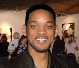 Actor Will Smith visiting Peter Engels at Art Basel Miami, Tiger Woods portrait painting in the background