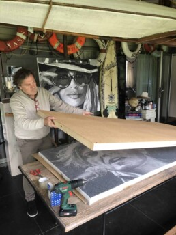 Peter Engels packing the David Bowie portrait painting for transport to the new Monaco owner