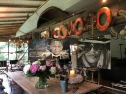 James Bond actor Daniel Craig portrait painting by Peter Engels artist in his atelier next to Brigitte Bardot