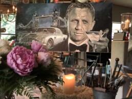 Daniel Craig portrait painting by Peter Engels artist in his studio